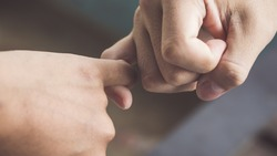 Depth of field, Vintage Style of Two hands hook each other's little finger concept of promise, heal