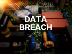 Depth of fill and bokeh effect for electronic circuit board, with flare and wording DATA BREACH on top of circuit. Security, data, technology and privacy concept.