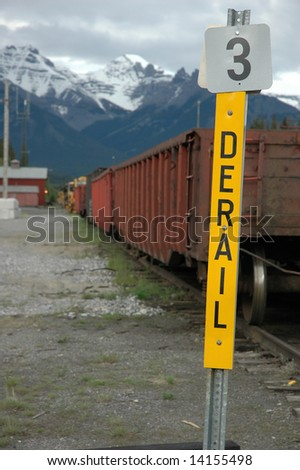 derail sign and row of cars