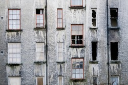 Derelict abandoned council house in poor housing crisis ghetto estate slum in Port Glasgow uk