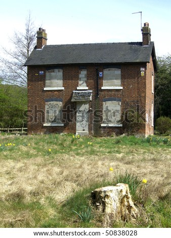 Derelict and boarded up house