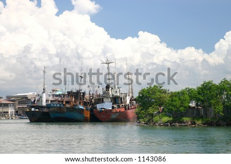 derelict boats with clouds