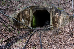 Derelict narrow-gauge rail / tracks of the East Broad Railroad lead up to a long abandoned tunnel in Pennsylvania.