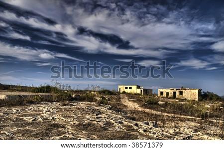 Derelict wartime British barracks lying in ruins at Selmun in Malta Zdjęcia stock ©
