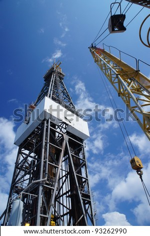 Derick of jack up drilling rig with the rigcrane on Sunny Day