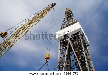 Derick of jack up drilling rig with the yellow rig crane