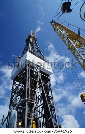 Derick of jack up drilling rig with the yellow rigcrane