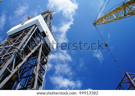 Derick of Offshore Jack Up Drilling Rig And A Rig Crane