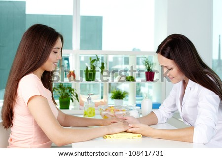 Dermatologist consulting her client on hand care