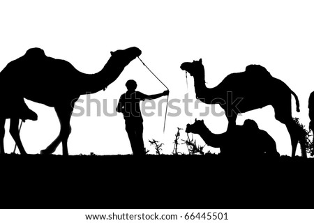 Desaturated photo shows silhouette of camels and a camel herder at the Pushkar Camel Fair in India