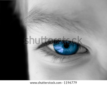 desaturated view of part of a human face with the eye left in color