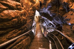 Descent into limestone caves for speleological sightseeing