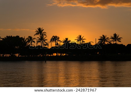Description:  Late evening glow and silhouette at Honolulu Lagoon. Title:  \
