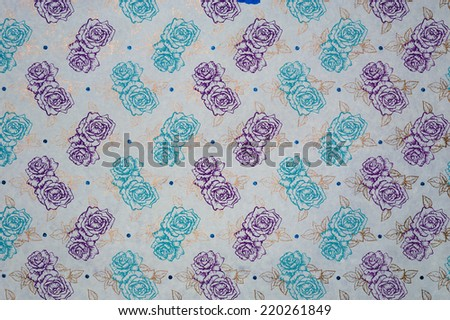 Description:  Purple and turquoise flowers with gold leaf on a champagne background. Title:  Purple and turquoise flowers with gold stems.