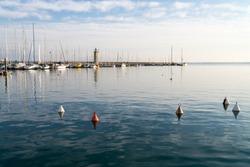 Desenzano lighthouse and marina, Garda lake, Italy