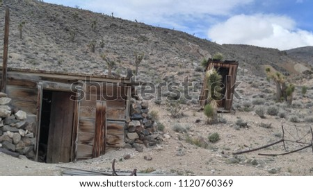 desert cabin and outhouse at...
