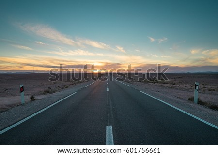 Desert Highway at dusk near Ouarzazate, Morocco