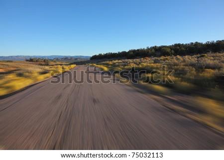 Desert in California. A car racing on high speed