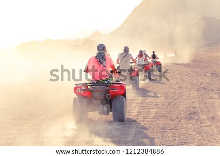 Desert in Egypt. Sharm el Sheikh. Sand and Sand Borkhan. Rock and sunset. Quad Cycle Travel. Excursion with people. Stock photo ©