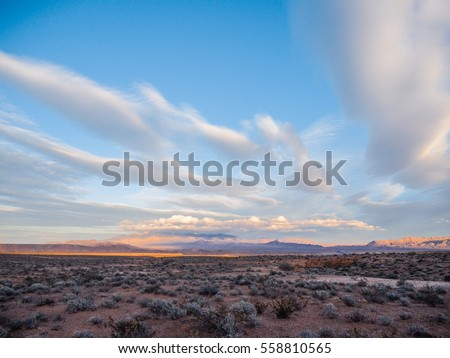 desert landscape with blue sky and cloudy background