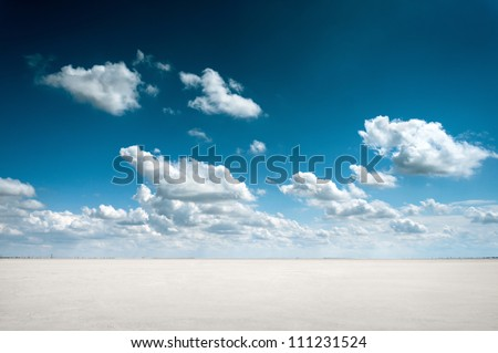 desert landscape with deep blue sky and clouds #111231524