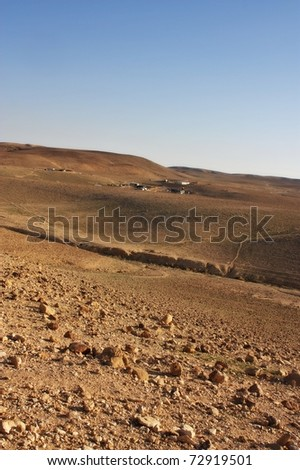 Desert mountains and a Bedouin village