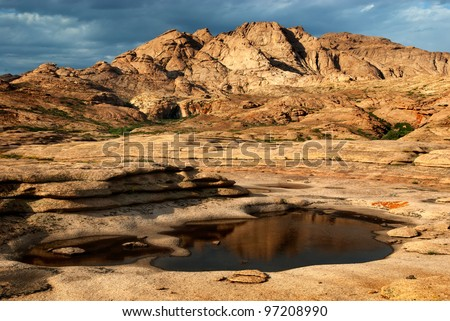 Desert mountains Bektau-Ata in Kazakhstan after rain - stock photo