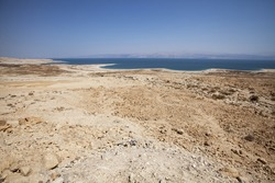 Desert on the shore of dead sea, gravel and dirt, sunny summer day