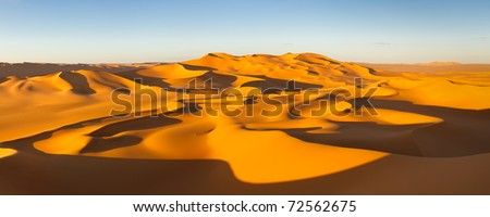 Desert Panorama - Endless sand dunes at sunset - Murzuq Desert, Sahara, Libya