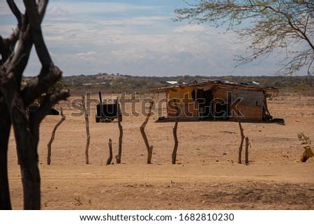 desert peru sandy soil sand sun sunset blue sky in the desert drought dry north peru poverty misery indigence house penury people