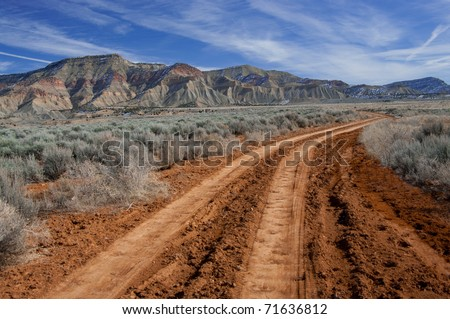 Desert Road:  A rough dirt road leads into the North Fruita Desert in western Colorado. - stock photo
