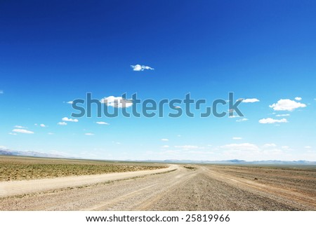 Desert road  in Mongolia with dramatic sky