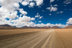 desert road, white clouds and deep blue sky