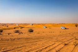 Desert safari and sand dunes bashing in public vehicles in Dubai, United Arab Emirates. Dubai is famous for Sand dunes bashing, Desert safari in the all of United Arab Emirates. Dubai Tourism. Travel.