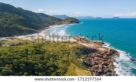 Deserted beach behind the mountain in Guarda do Embaú. Beautiful beach among green mountains in Santa Catarina, Brazil Foto stock ©