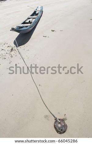 Deserted canoe on a beach, Bahia, Brazil