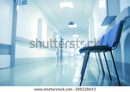 Deserted hospital corridor, concept of extended waiting.