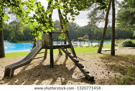 Deserted outside swimming pool in a forest in the summer #1320771458