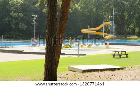 Deserted outside swimming pool in a forest in the summer #1320771461