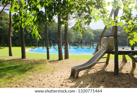 Deserted outside swimming pool in a forest in the summer #1320771464