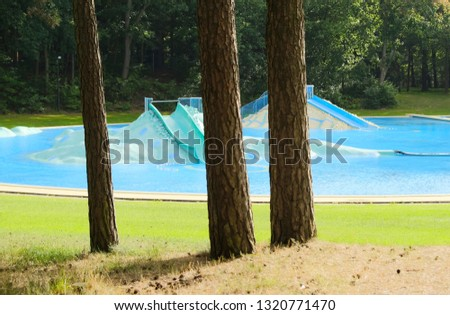 Deserted outside swimming pool in a forest in the summer #1320771470