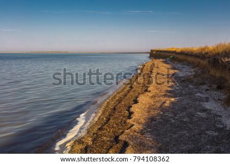 Deserted precipitous beach near the salt lake #794108362