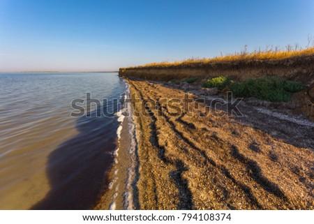 Deserted precipitous beach near the salt lake #794108374
