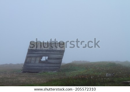 Deserted weathered cabin in Nordic landscape