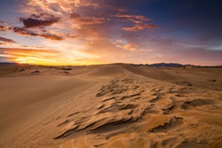 Deserts and Sand Dunes Landscape at Sunrise.