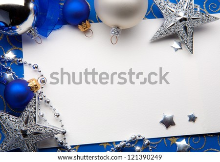Design a Christmas greeting card with Christmas Decorations on a blue background