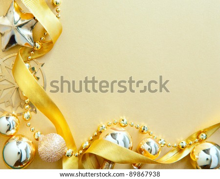 Design a Christmas greeting card with gold Christmas tree decorations on the background paper