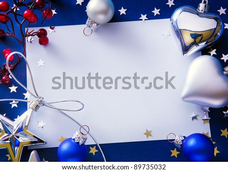 Design a Christmas greeting with a paper on a blue background