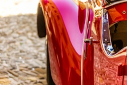 Design and red color of vintage car body