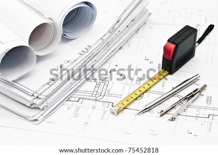 Design and working drawings with pencils, rule and compasses - stock photo